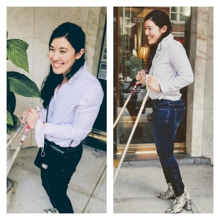 Xian smiling into the sun in a gray plaid Jacket holding her ski poles from an upwards angle